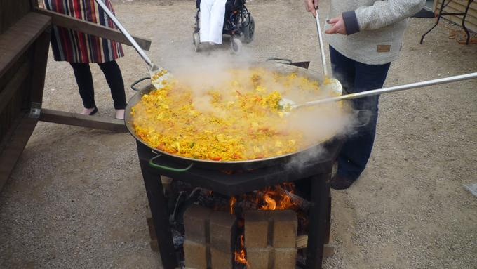 Rotary paella being cooked